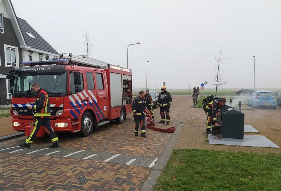 Brand in ondergrondse afvalcontainer Cicero. (foto's)